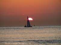 Sailboat silhouette at Scheveningen beach (the Netherlands)